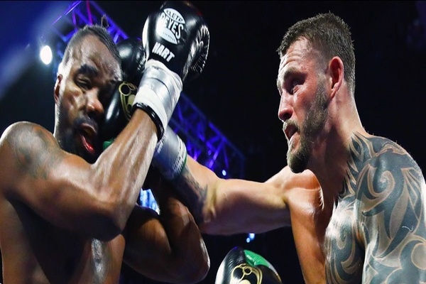 Relentless Joe Smith Jr. knocks Jesse Hart down, wins fight by split decision