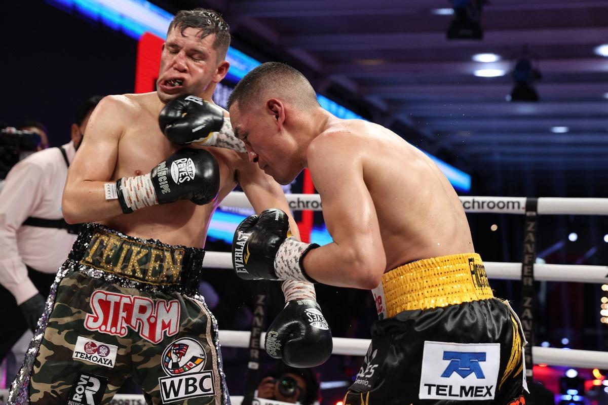 Max Boxing - Main Lead - Juan Francisco Estrada gets off the floor to stop  Carlos Cuadras in war of attrition